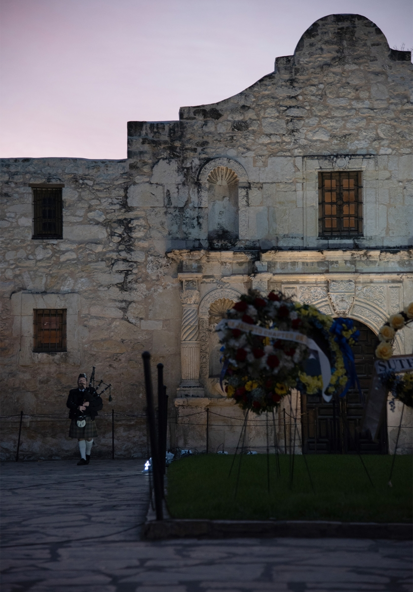 A bagpipe player performs during Dawn at the Alamo ceremony, which observes the day the compound fell in 1836, March 6, 2019, at Alamo Plaza.