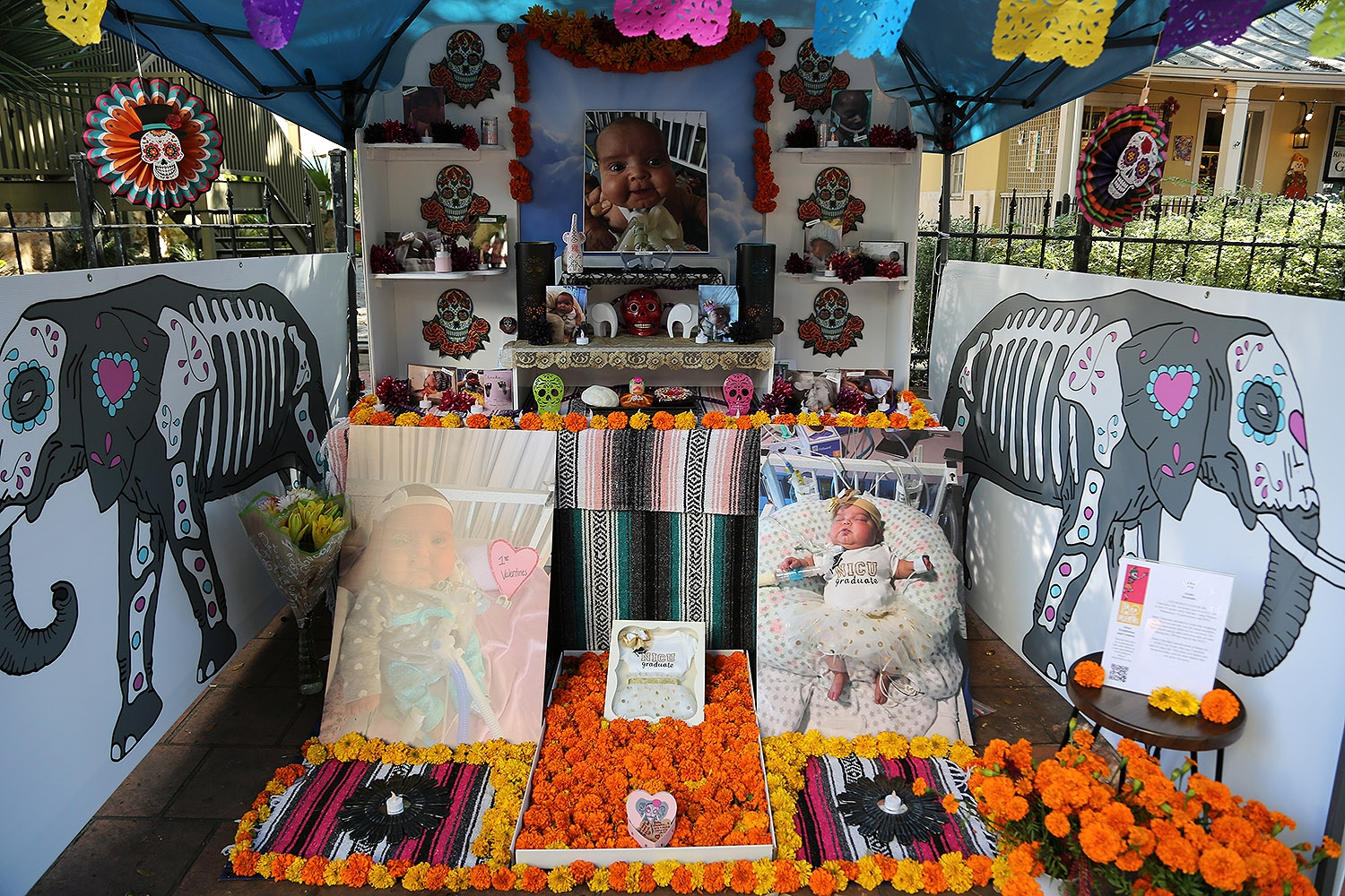 "Jaime Alvarado's altar titled ""Cherokee's Cherubs"" remembers his daughter, Cherokee Elle Alvarado who was born in August 2016 at 23 weeks, and died in April the next year. Included in this piece are babies of parents that belong to a support group called Share Group. <em><b>Photo by Ben Olivo 