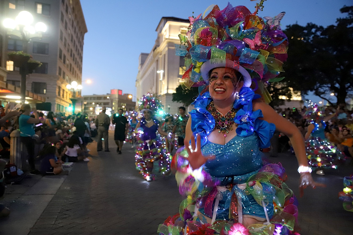 A Las Charangas dancer shows off her moves down Alamo Plaza in the Flambeau Parade on Saturday. <em>Photo by Brianna Rodrigue | Heron contributor</em>