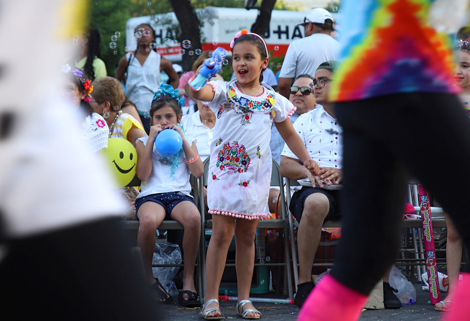 A young girl shoots her bubble gun at runners participating in the Fiesta Fandango Run on Saturday. <em>Photo by Brianna Rodrigue | Heron contributor</em>