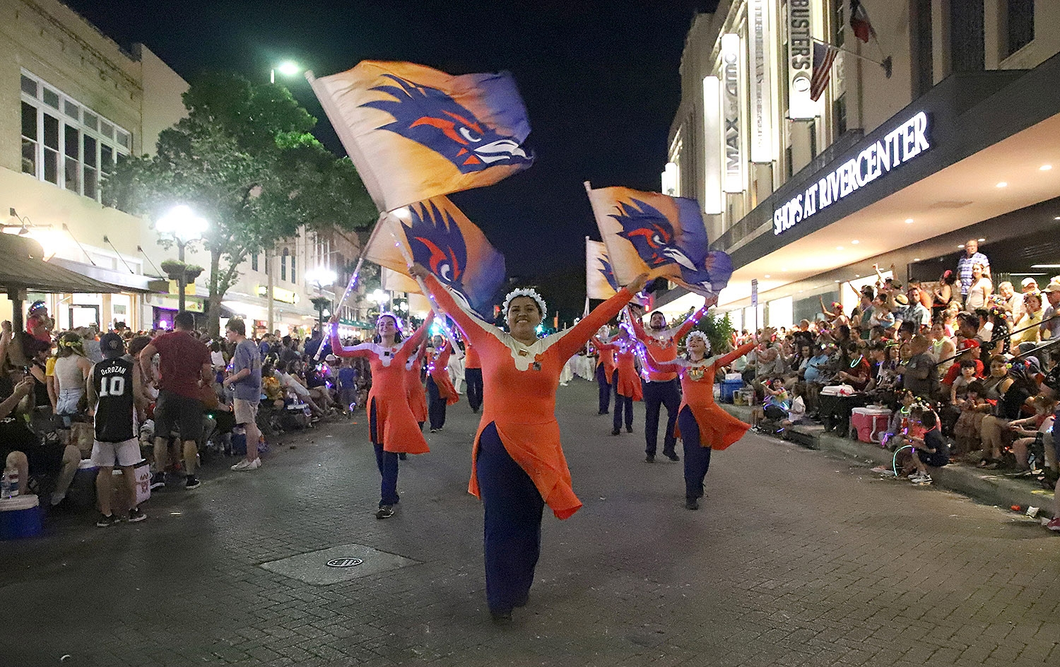The University of Texas at San Antonio Color Guard stroll down south alamo street during the Flambeau Parade on Saturday. <em>Photo by Brianna Rodrigue | Heron contributor</em>
