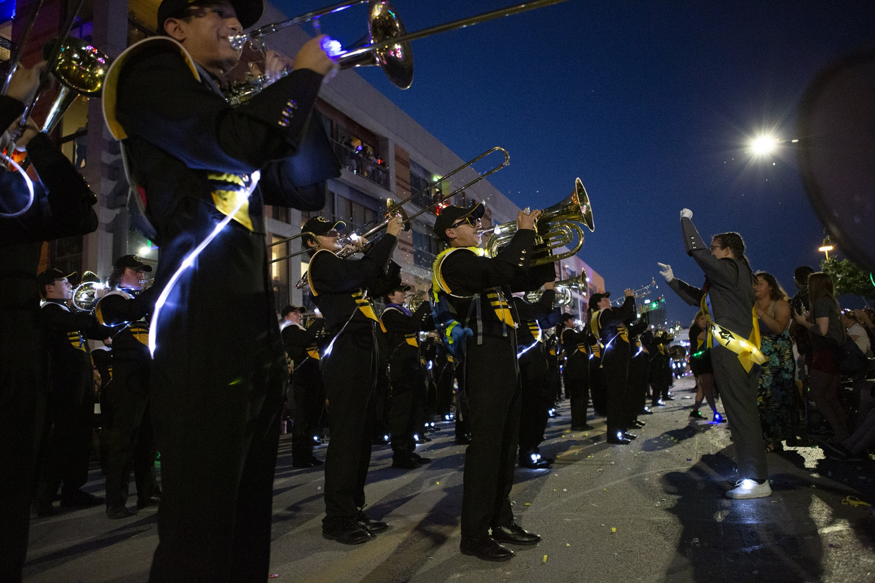 The East Central High School Hornet Band stops to play to the crowd during the Fiesta Flambeau Parade on Saturday, April 27. <em>Photo by Kara Hawley | Heron contributor</em>