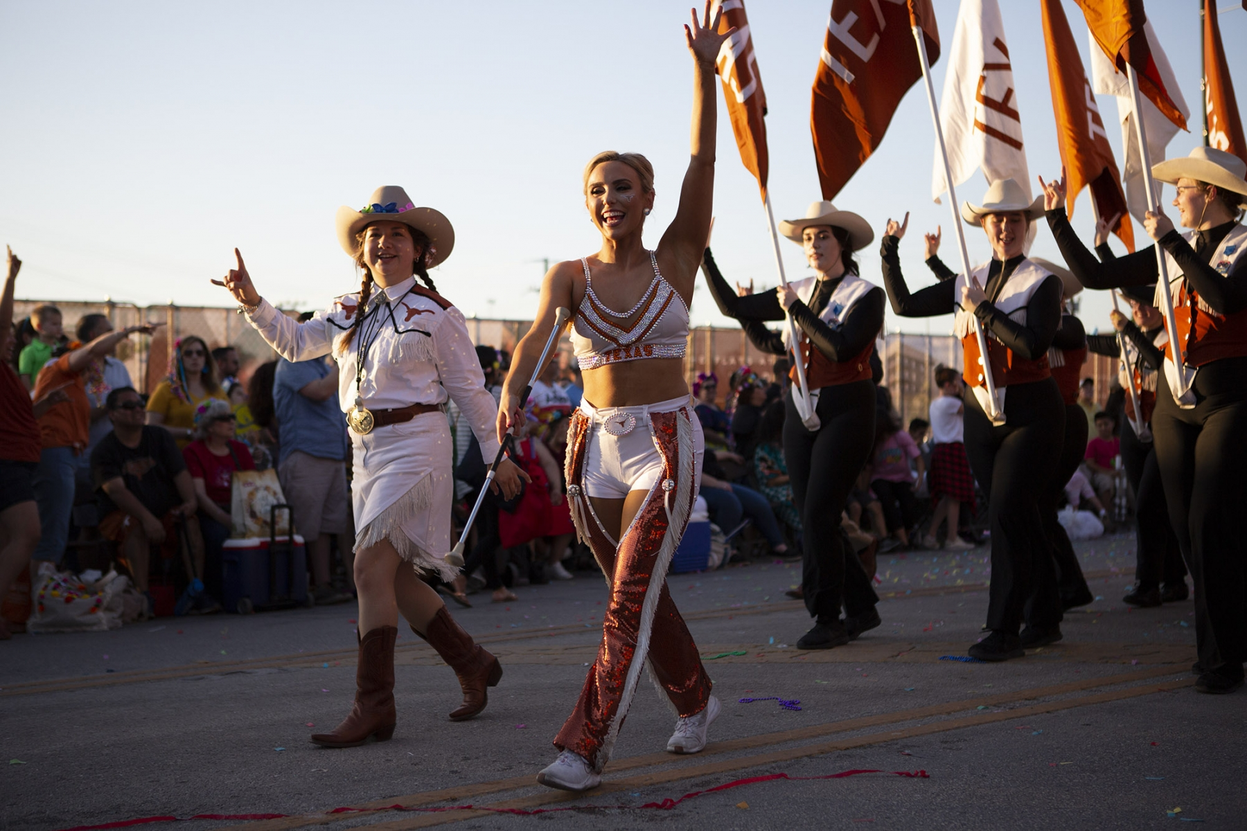 UT's baton twirler leads the Longhorn Band in the Fiesta Flambeau Parade on Saturday, April 27. <em>Photo by Kara Hawley | Heron contributor</em>