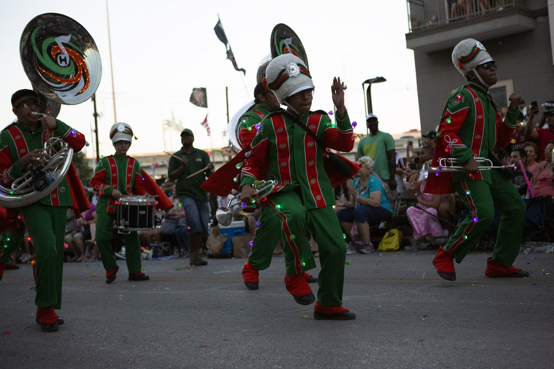 The Sam Houston highschool band busts a move during the Fiesta Flambeau Parade on Saturday, April 27. <em>Photo by Kara Hawley | Heron contributor</em>
