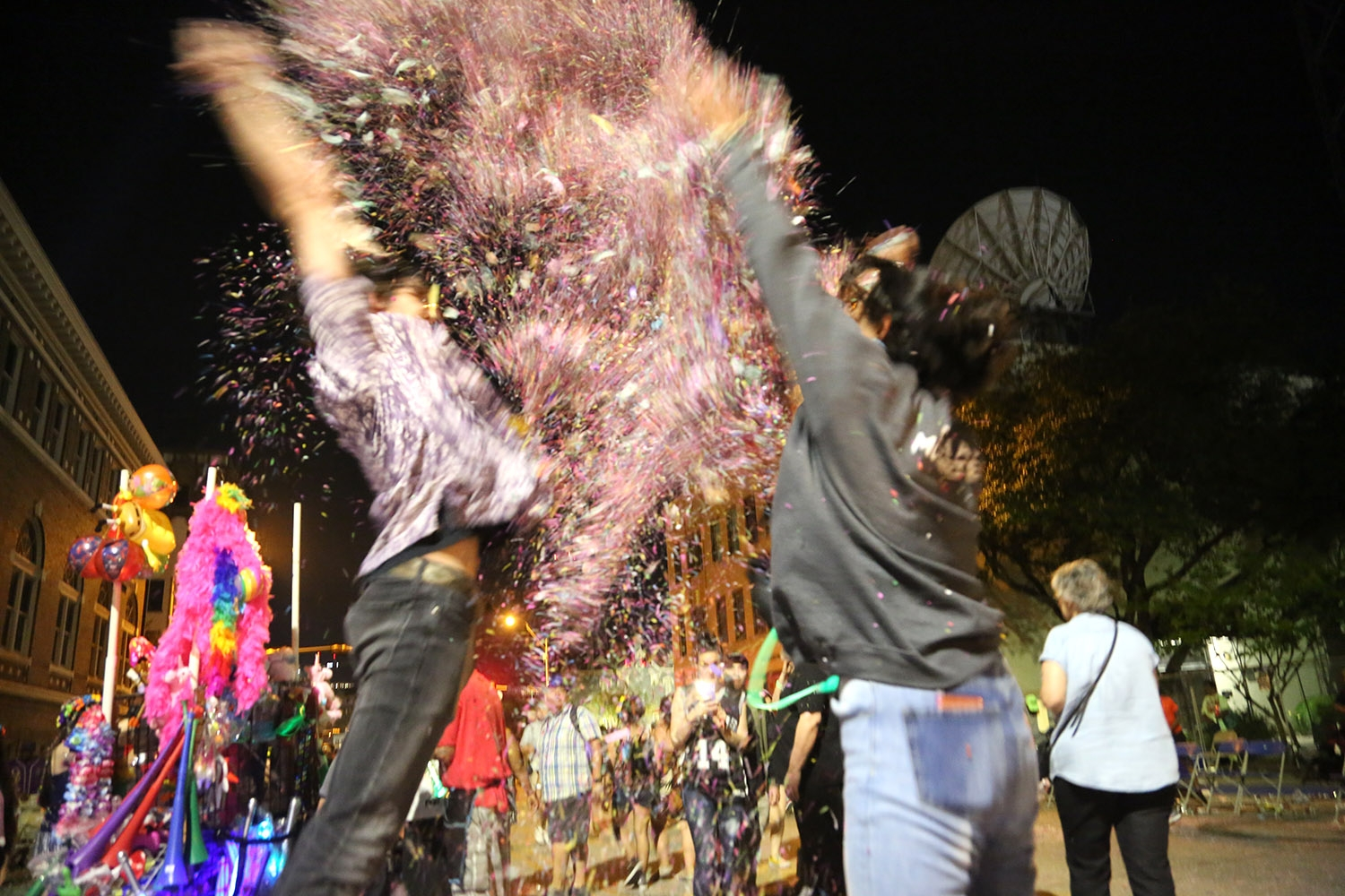 Confetti wars ensued on Broadway after the Fiesta Flambeau Parade on Saturday, April 27. <em>Photo by Ben Olivo | Heron</em>
