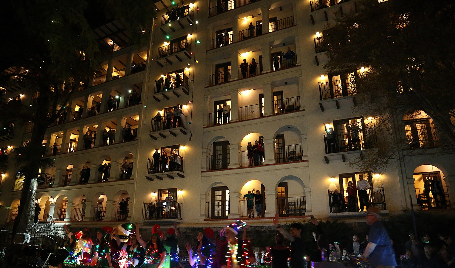 A barge floats past the Omni La Mansión del Rio Friday night during the annual Ford Holiday River Parade. <em><b>Photo by Ben Olivo | Heron</b></em>