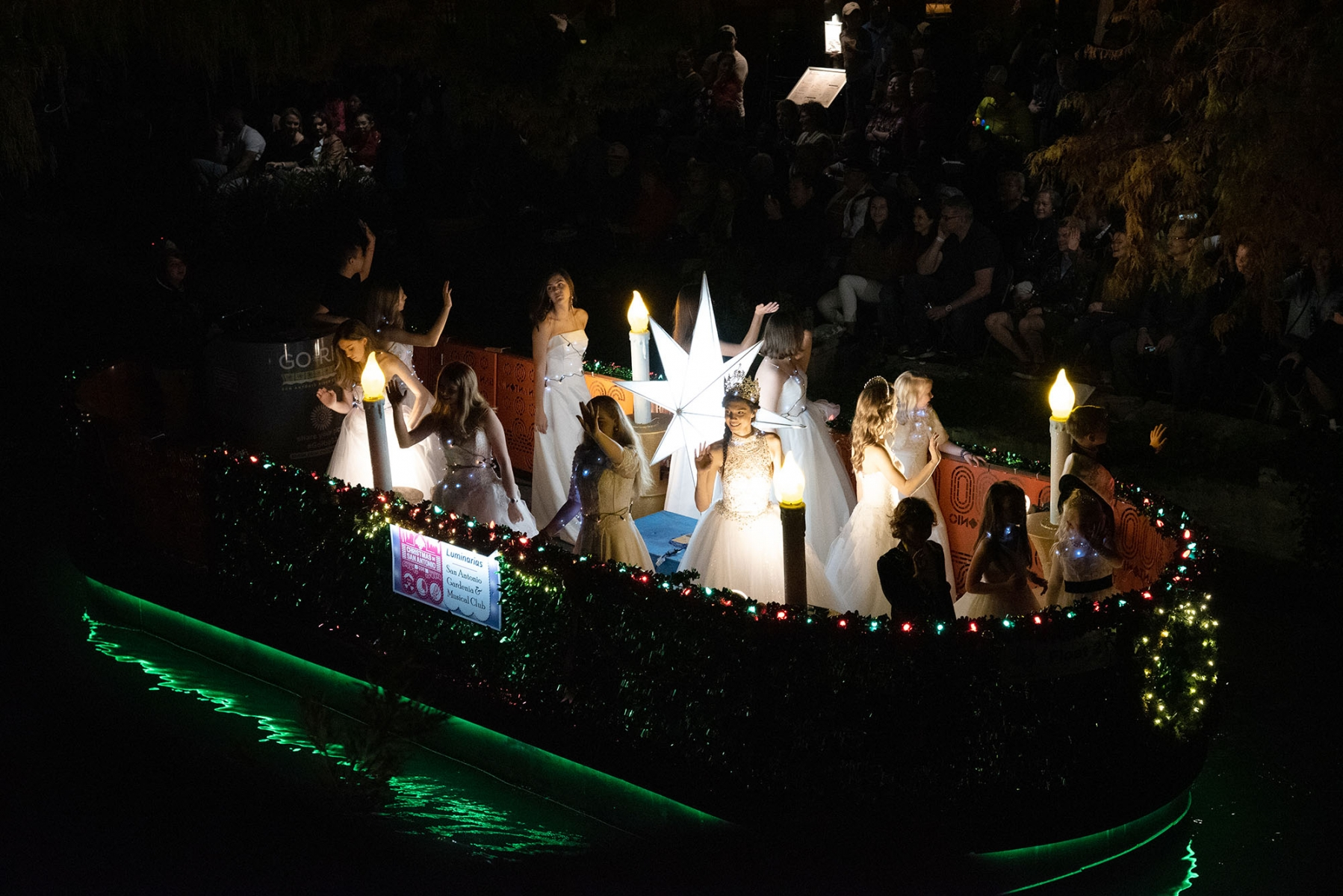 A barge full of princesses floats down the River Walk during the annual Ford Holiday River Parade Friday night. <em><b>Photo by V. Finster | Heron</b></em>