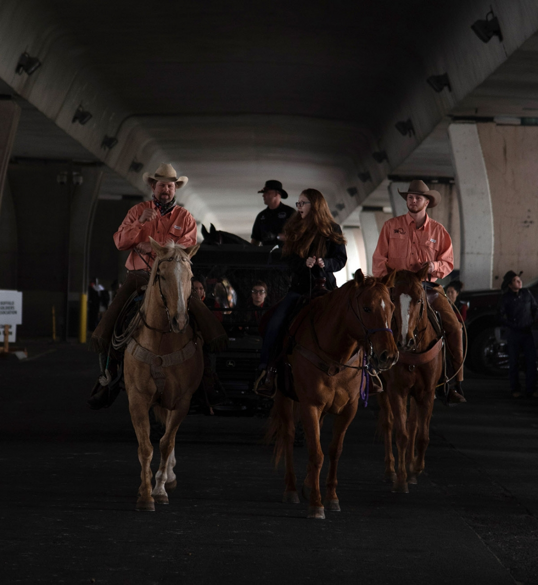 Participants wait before the Western Heritage Parade and Cattle Drive Feb. 2 under I-35 at Houston St. <em><b>V. Finster | Heron</b></em>