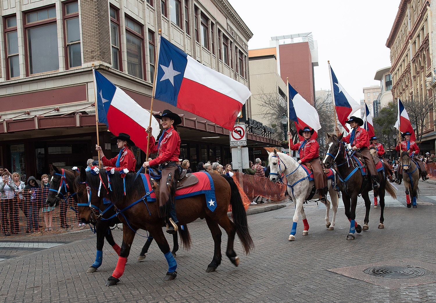 Participants hold their flags during the Western Heritage Parade and Cattle Drive Feb. 2 on Houston Street. <em><b>V. Finster | Heron</b></em>