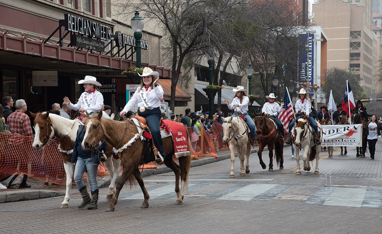 Participants wave at the crowd during the Western Heritage Parade and Cattle Drive Feb. 2 on Houston Street. <em><b>V. Finster | Heron</b></em>