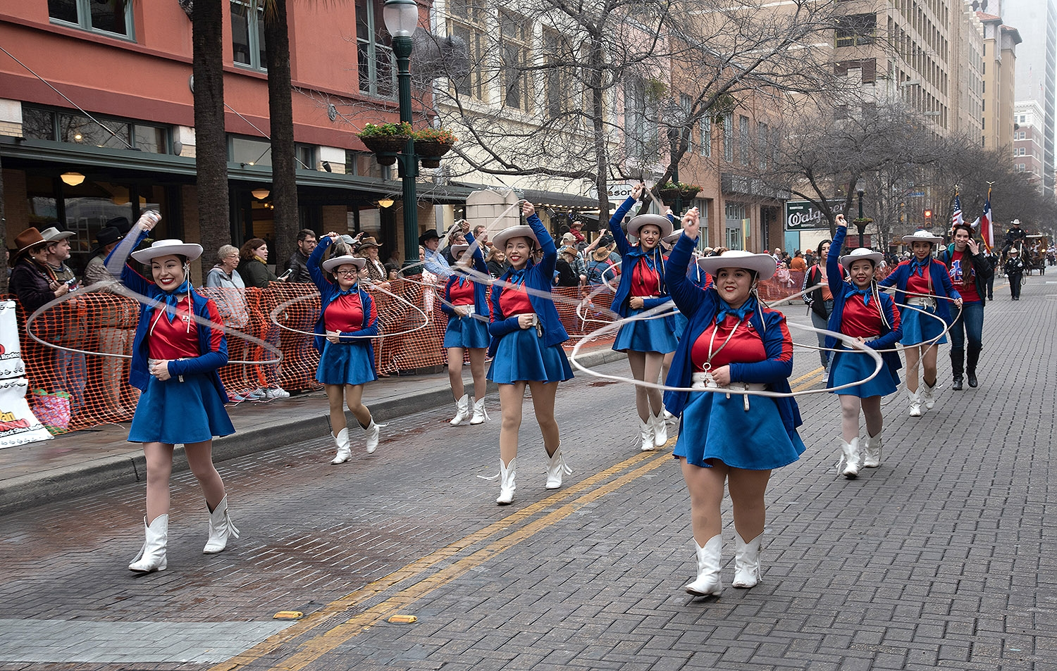Members belonging to the Thomas Jefferson High School Lassos perform during the Western Heritage Parade and Cattle Drive Feb. 2 on Houston Street. <em><b>V. Finster | Heron</b></em>