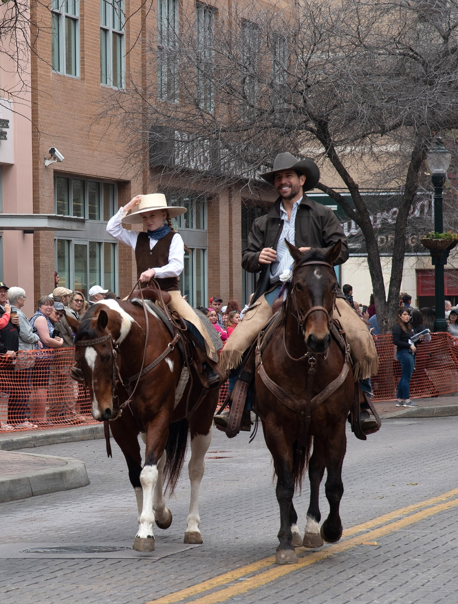 KK Alarid tips her hat to the crowd during the Western Heritage Parade and Cattle Drive Feb. 2 on Houston Street. <em><b>V. Finster | Heron</b></em>