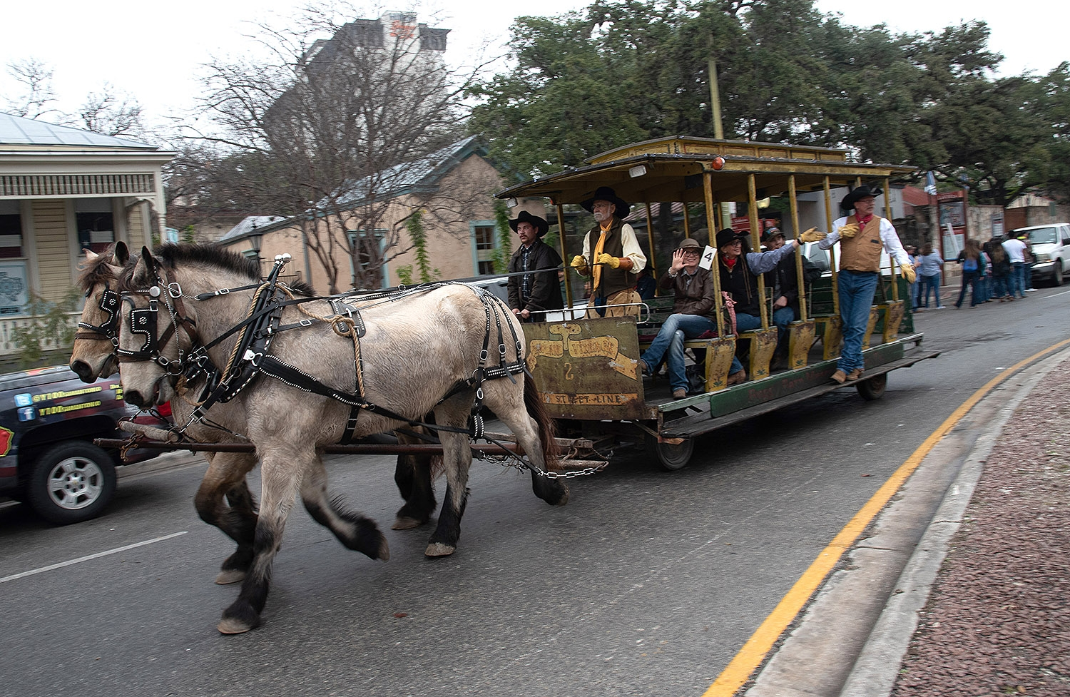 Participants on the Buggy Barn Museum wagon wave to bystanders after the Western Heritage Parade and Cattle Drive Feb. 2. <em><b>V. Finster | Heron</b></em>