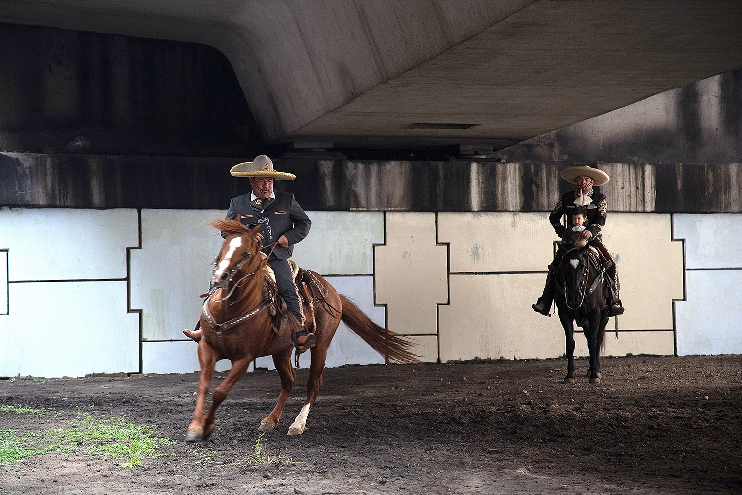 Members of Charros de Bejar practice before the Western Heritage Parade and Cattle Drive Feb. 2 under I-35 at Houston St. <em><b>Photo by V. Finster | Heron</b></em>