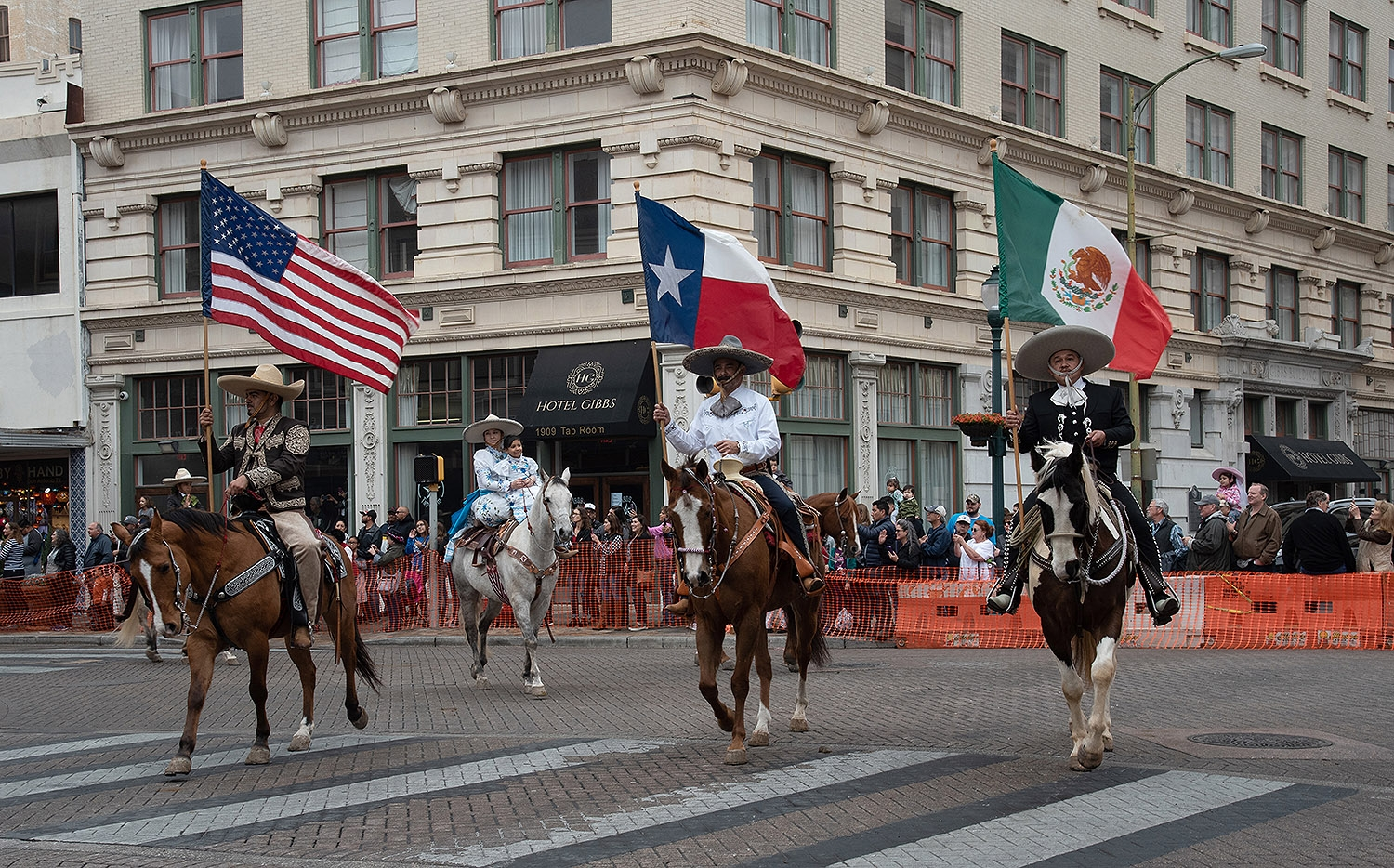 Participants hold their flags during the Western Heritage Parade and Cattle Drive Feb. 2 on S Alamo St. <em><b>V. Finster | Heron</b></em>