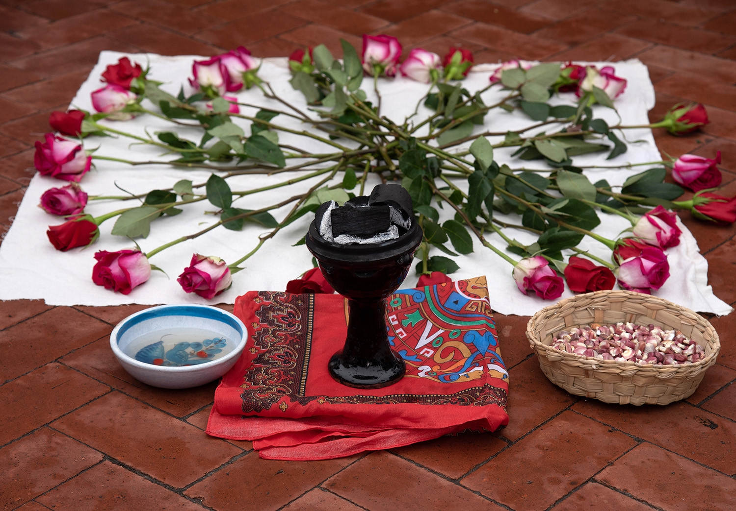 Items set out to accompany a blessing before the 29th annual San Antonio International Women's Day March at Milam Park on Saturday, March 2. <b><em>Photo by V. Finster | Heron</em></b>