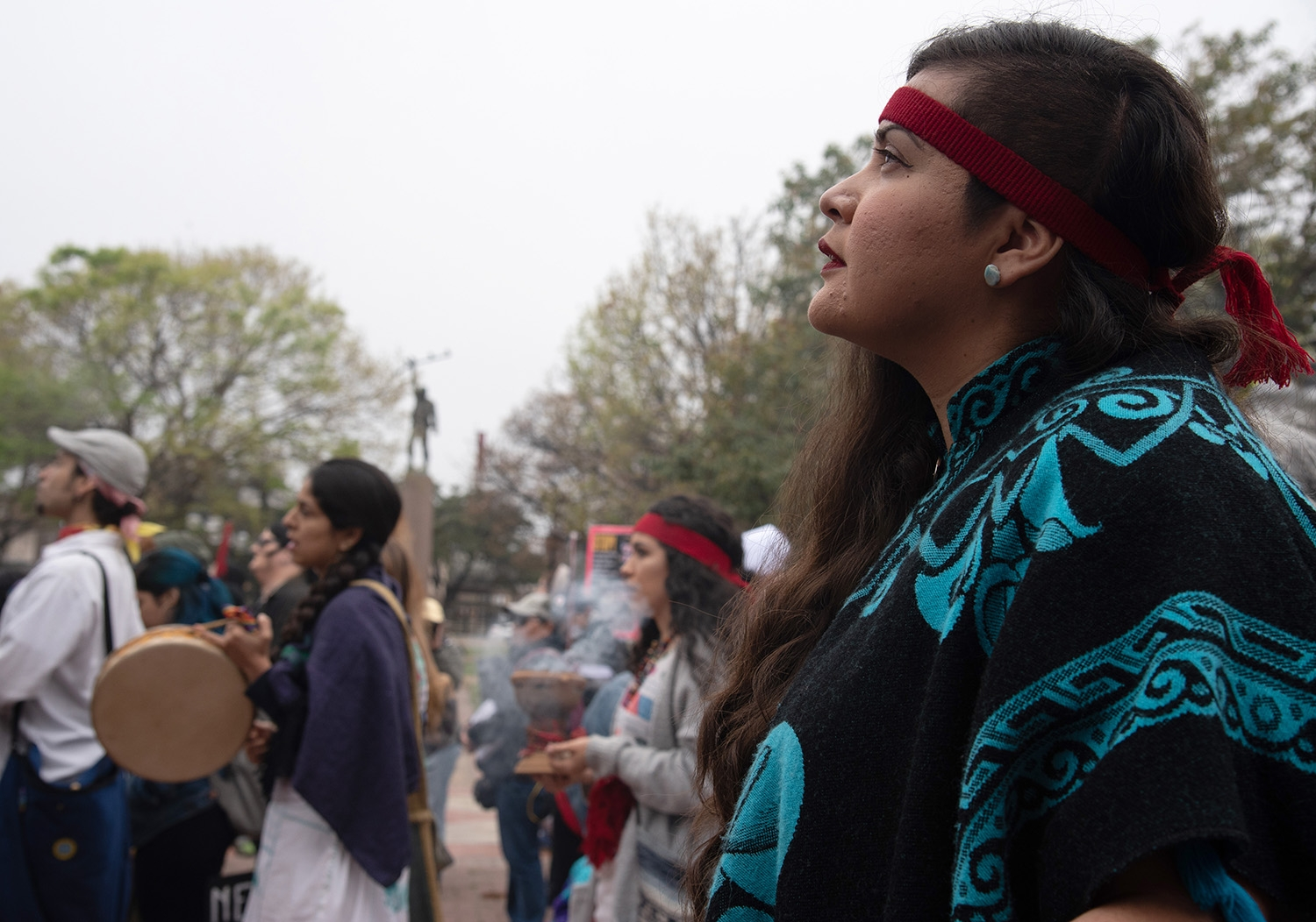 Dr. Susanna Ramirez, member of the Huitzilmeztli Tribe, leads a blessing before the 29th annual San Antonio International Women's Day March in Milam Park on Saturday, March 2. <b><em>Photo by V. Finster | Heron</em></b>