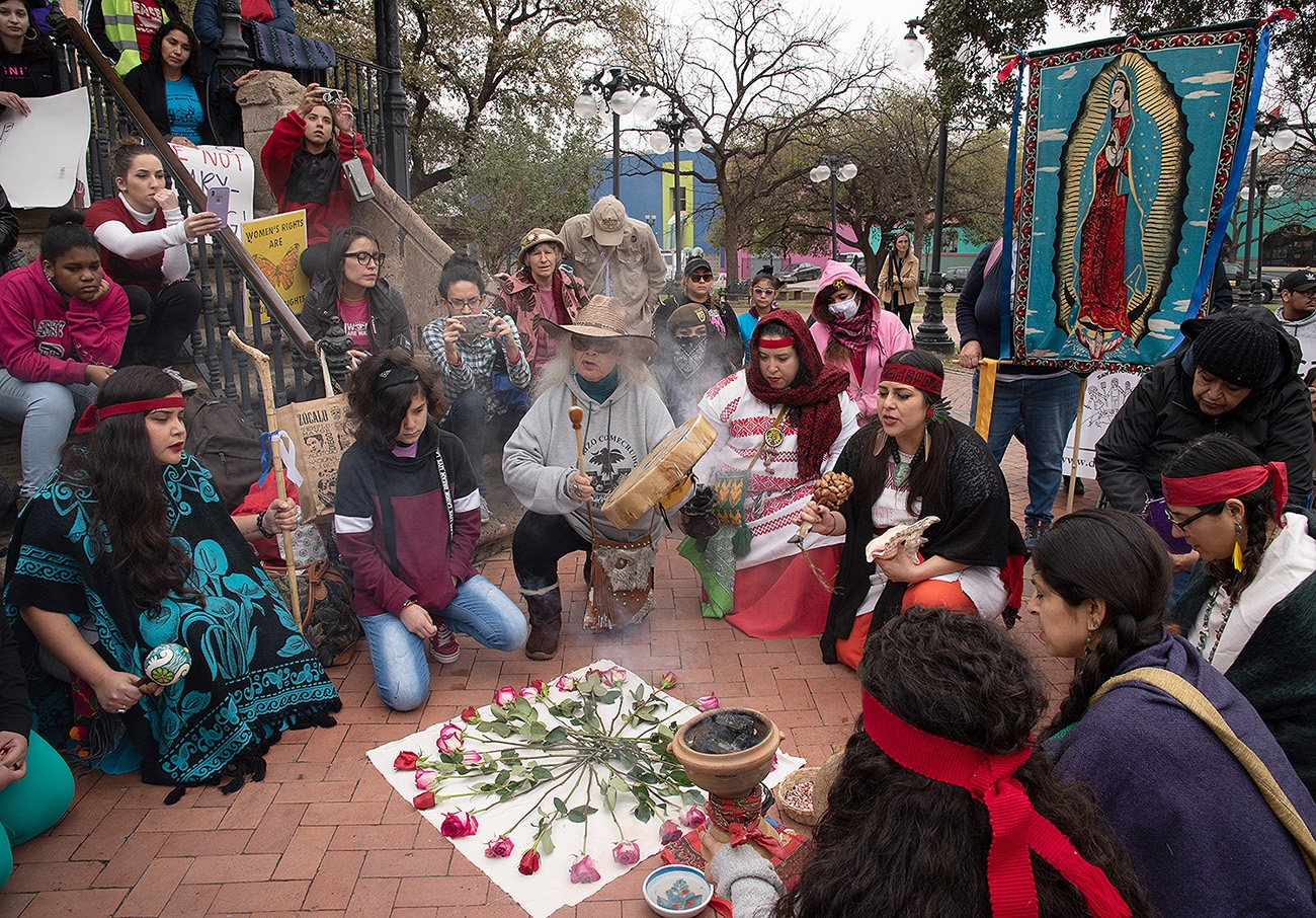 """""""Grandmother"""" Emma Ortega member of the Lipan Apache and Carrizo/Comecrudo Tribes sings to a crowd before the 29th annual San Antonio International Women's Day March in Milam Park on Saturday, March 2. <b><em>Photo by V. Finster 