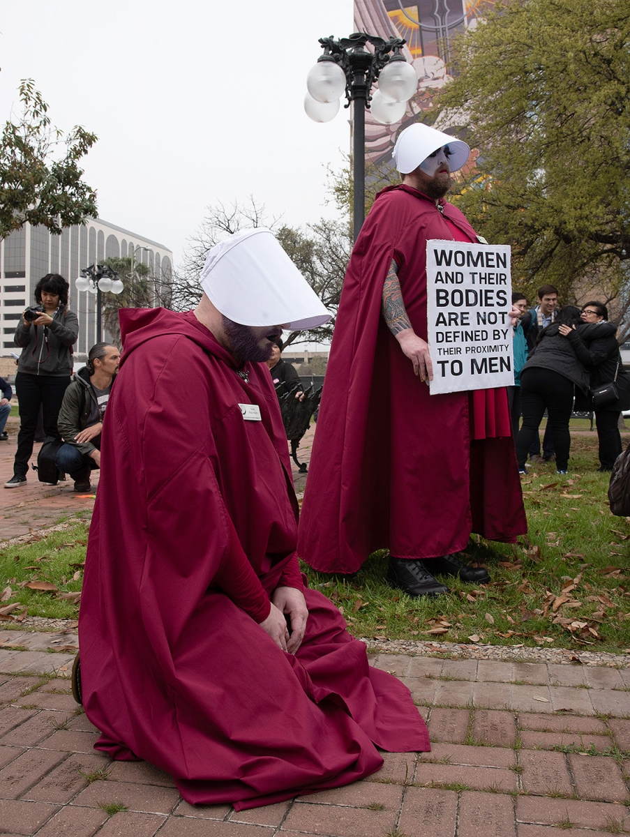Sister Katya Klyzm, member of Sisters of Perpetual Indulgence, Abbey of the Alamo Inc., kneels in reverence during a blessing before the 29th annual San Antonio International Women's Day March in downtown San Antonio on Saturday, March 2. <b><em>Photo by V. Finster | Heron</em></b>