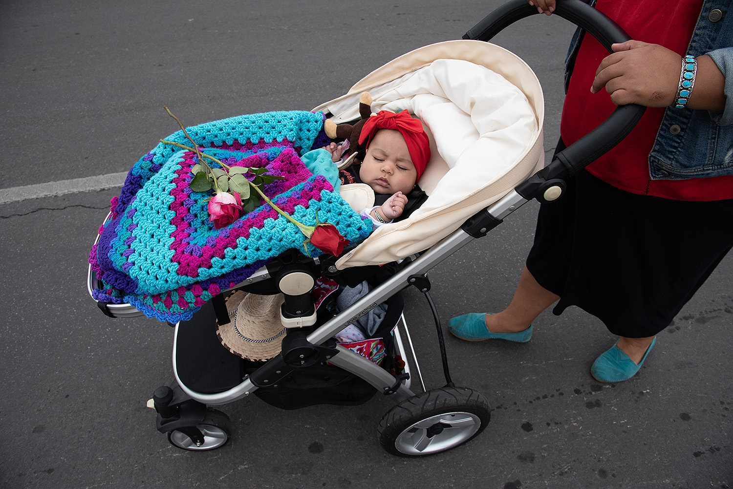 Maricela Olguin pushes daughter Aurora, 3 months, during the 29th annual San Antonio International Women's Day March in downtown San Antonio on Saturday, March 2. <b><em>Photo by V. Finster | Heron</em></b>