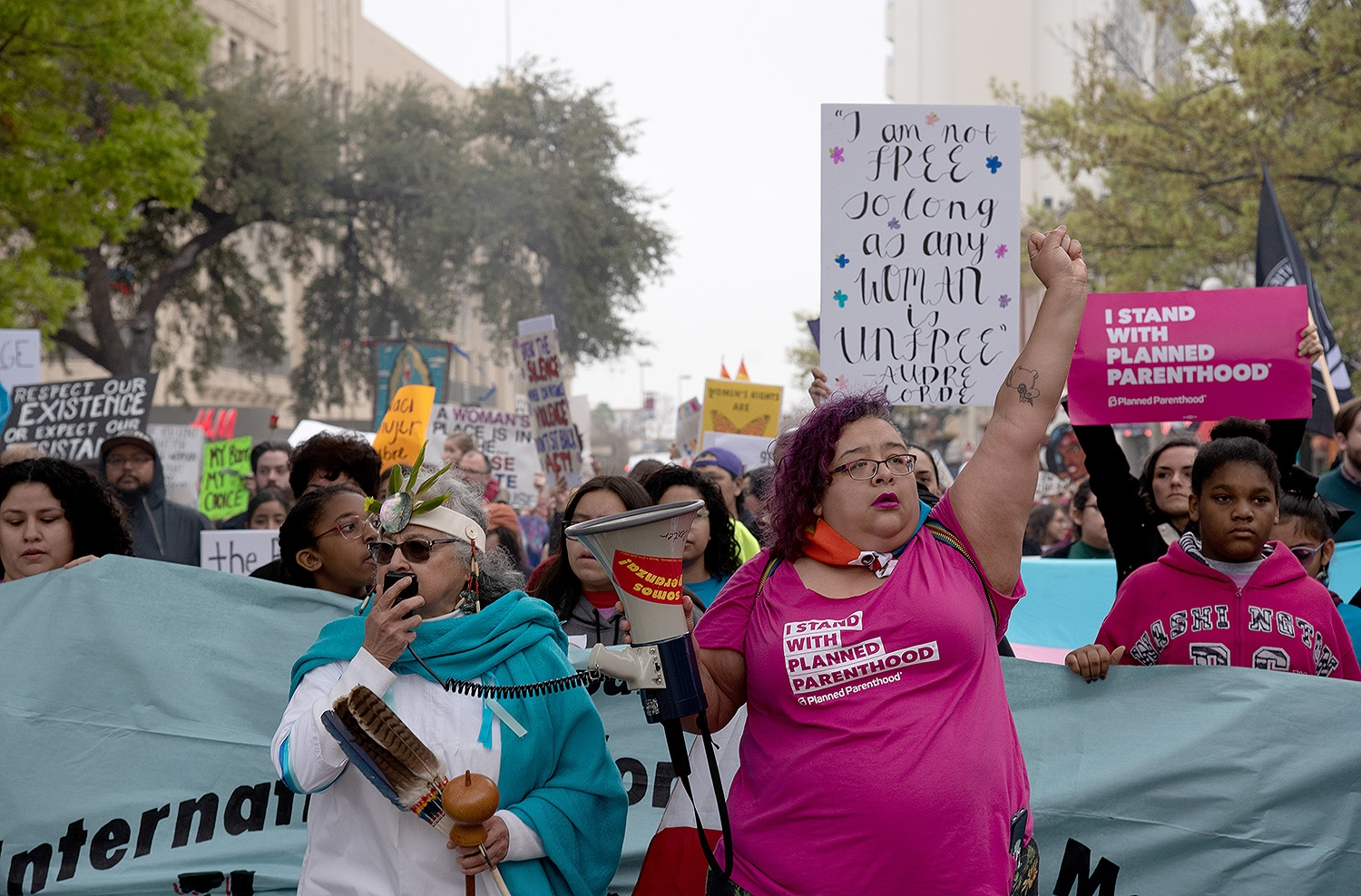 Participants walk through Alamo Plaza during the 29th annual San Antonio International Women's Day March in downtown San Antonio on Saturday, March 2. <b><em>Photo by V. Finster | Heron</em></b>