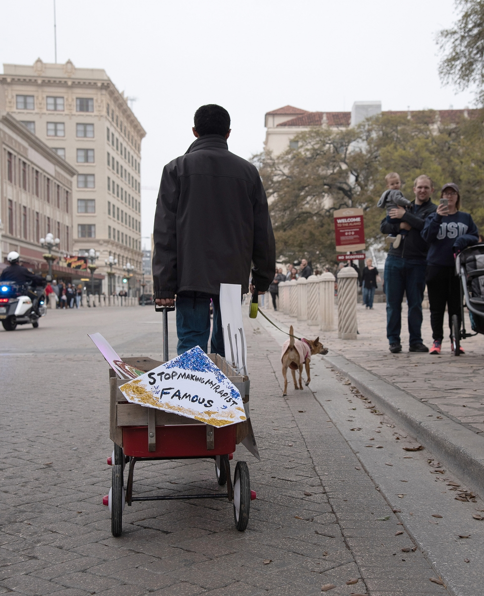 Johan Mejia pulls a wagon while walking his dog Princess during the 29th annual San Antonio International Women's Day March at Milam Park on Saturday, March 2. <b><em>Photo by V. Finster | Heron</em></b>