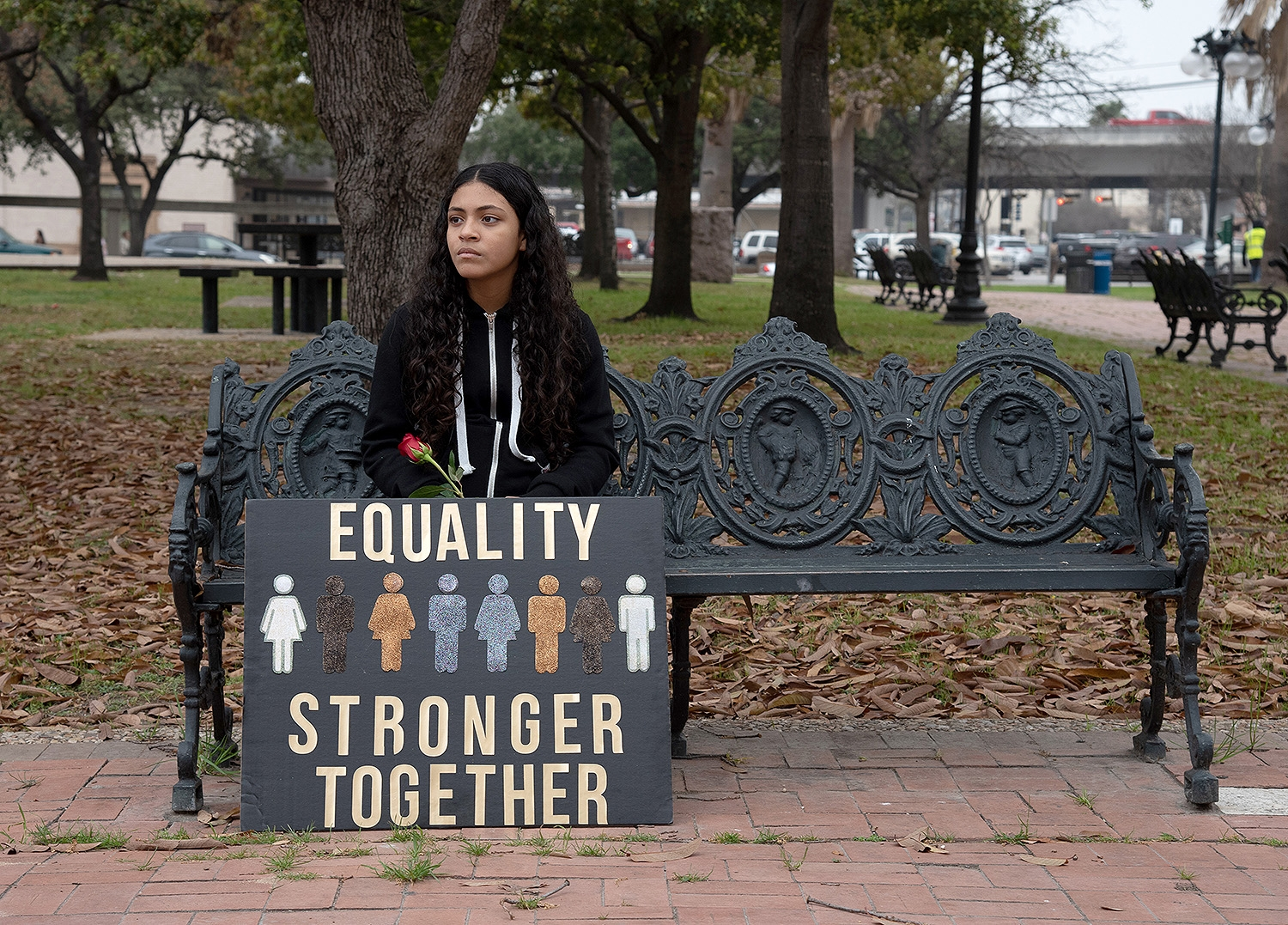 Isabella Sanchez, 12, sits on a bench after the 29th annual San Antonio International Women's Day March in Milam Park on Saturday, March 2. <b><em>Photo by V. Finster | Heron</em></b>