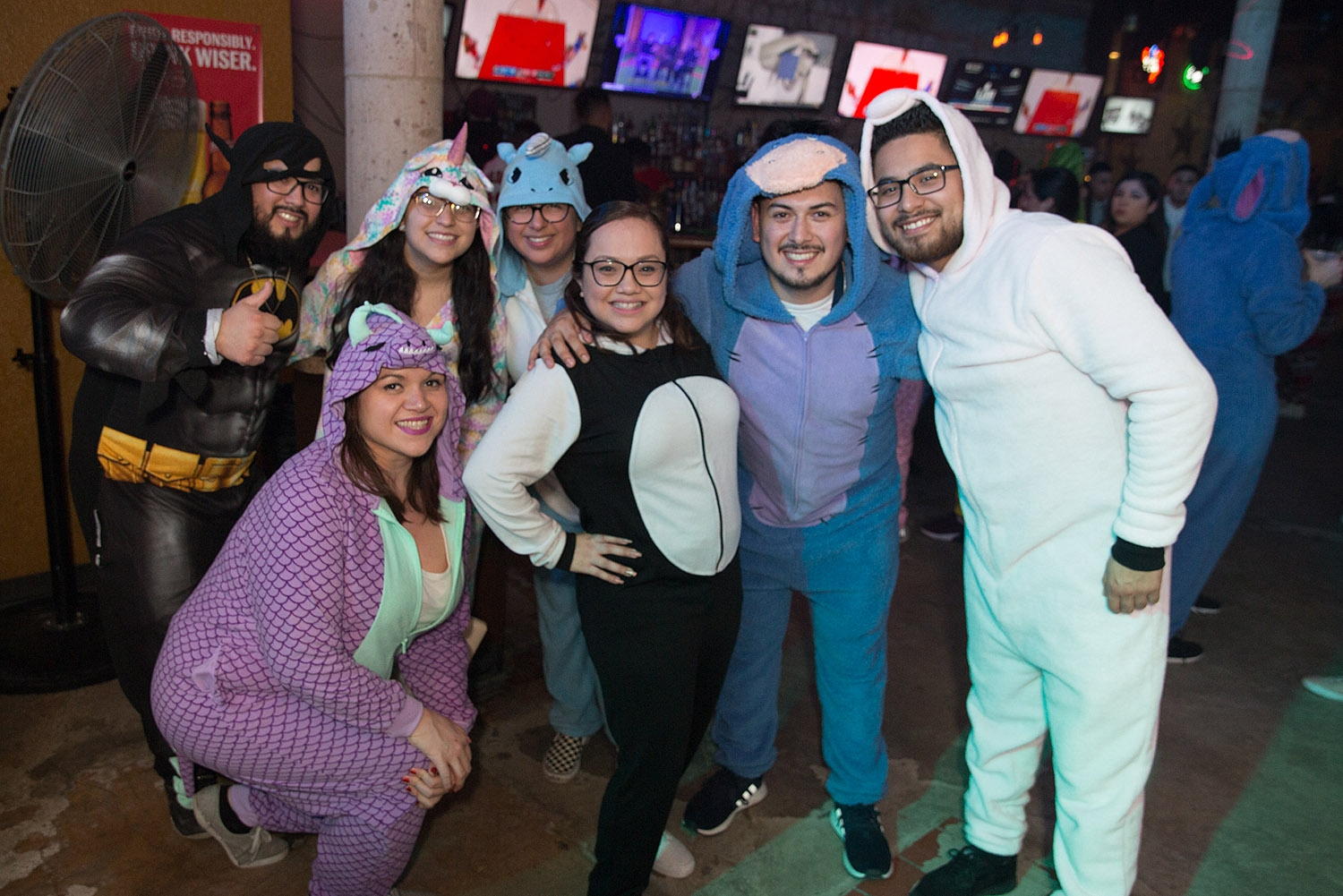 Pub runners have some drinks and bust a few moves during the onesie-themed Pub Run at Moses Rose's Hideout, Jan. 4, 2019. <em><b>Photo by B. Kay Richter | Heron contributor</b></em>
