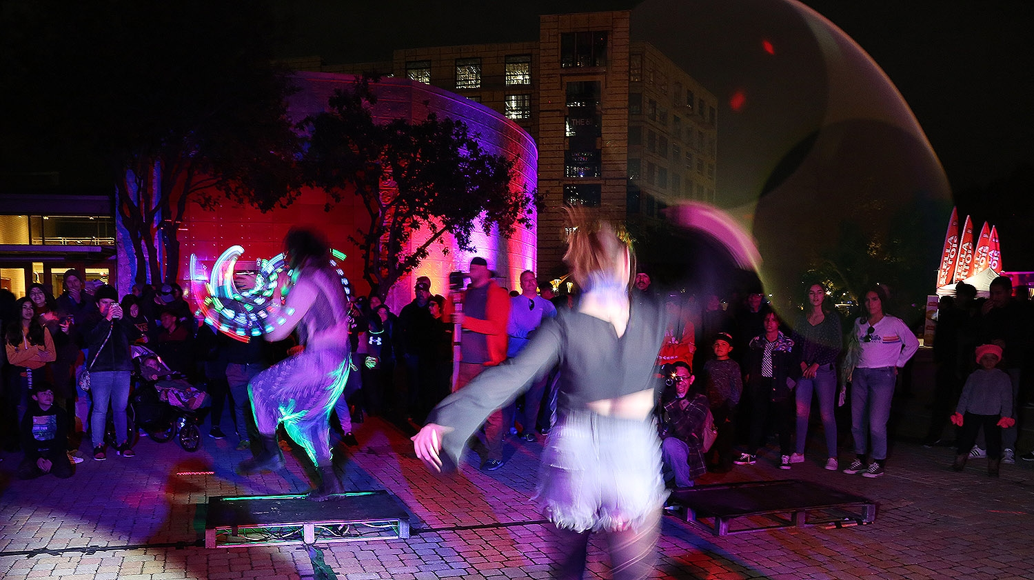 Performance artists  Christina Gonzalez and Andrew Salinas Nov. 11 at Luminaria. <em><b>Photo by Ben Olivo | Heron</b></em>