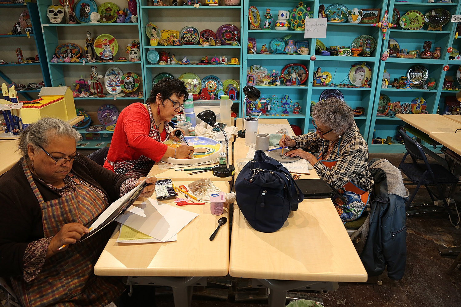 Angelita Merla (from left), Olga Martinez and Adriana Netro work on pieces Feb. 2 at the MujerArtes women's clay cooperative, 816 S. Colorado St.