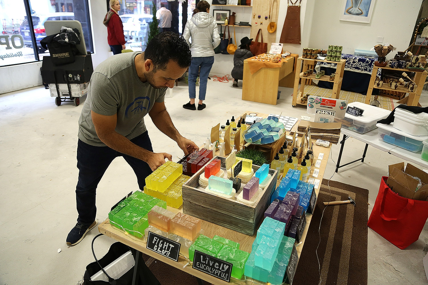 Jay Lopez with Girl & Guy Code Soaps sets up for the OPEN Holiday Market Friday, Dec. 7. <em><b>Photo by Ben Olivo | Heron</b></em>
