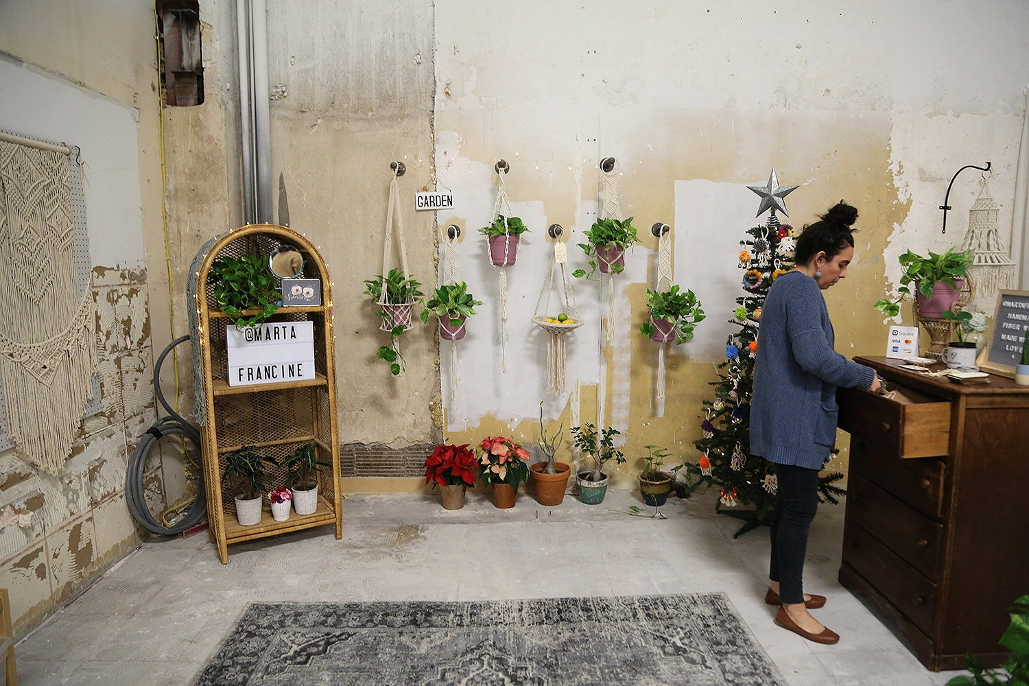 Marta Francine gets ready for the OPEN Holiday Market. <em><b>Photo by Ben Olivo | Heron</b></em>
