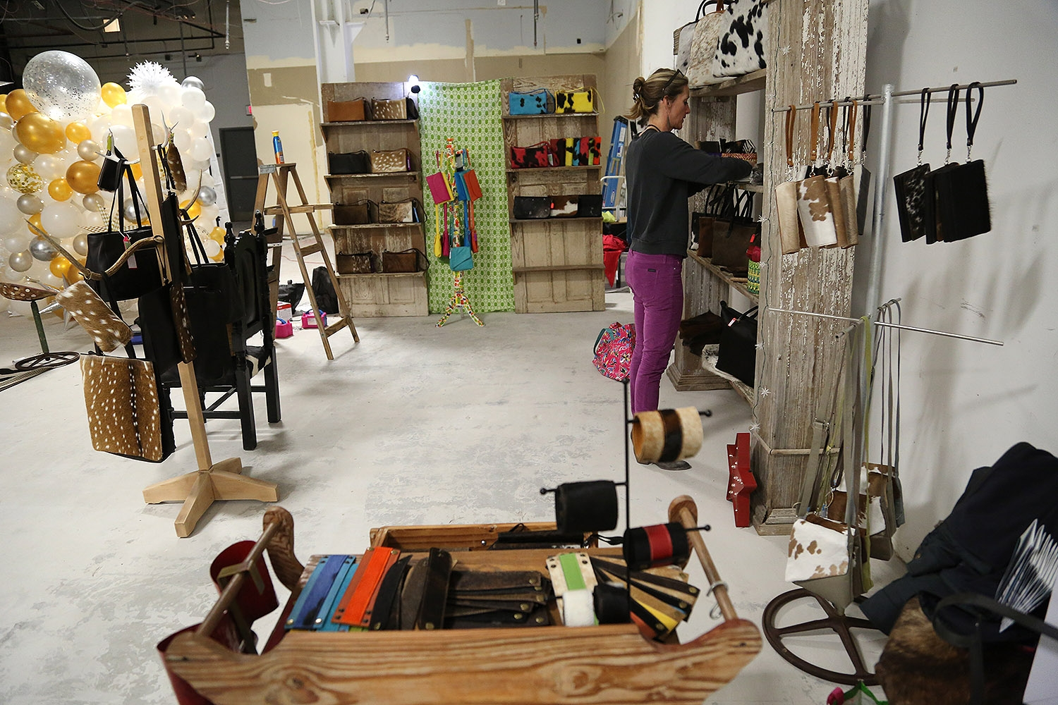 Heather Armstrong sets up her shop, Lulo Texas. <em><b>Photo by Ben Olivo | Heron</b></em>