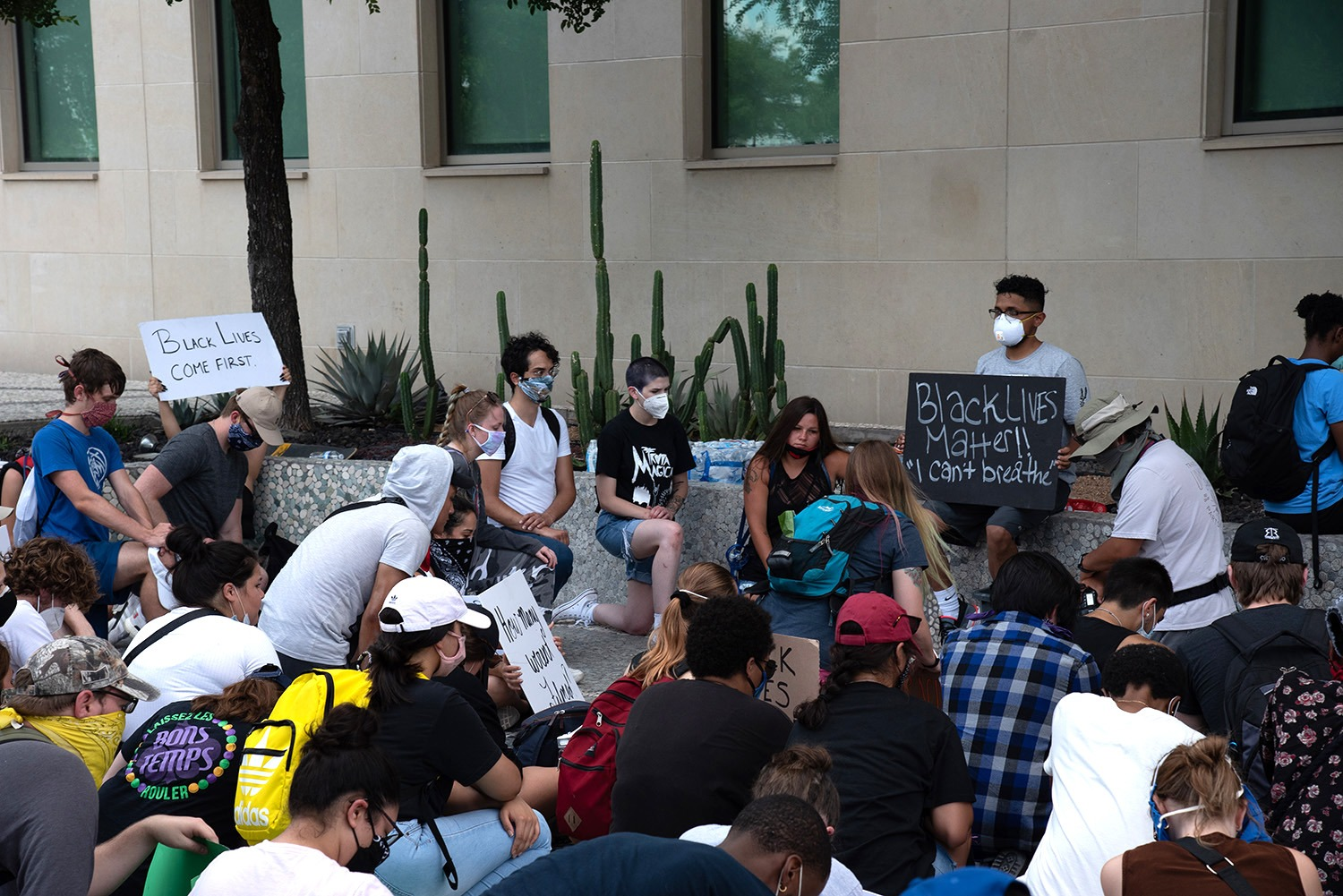 Protestors spend nine minutes in silence, many on a knee, during a peacful protest, Thursday, June 4 in front of the Public Safety Headquarters at 315 S Santa Rosa.Photo by V. Finster | Heron Contributor