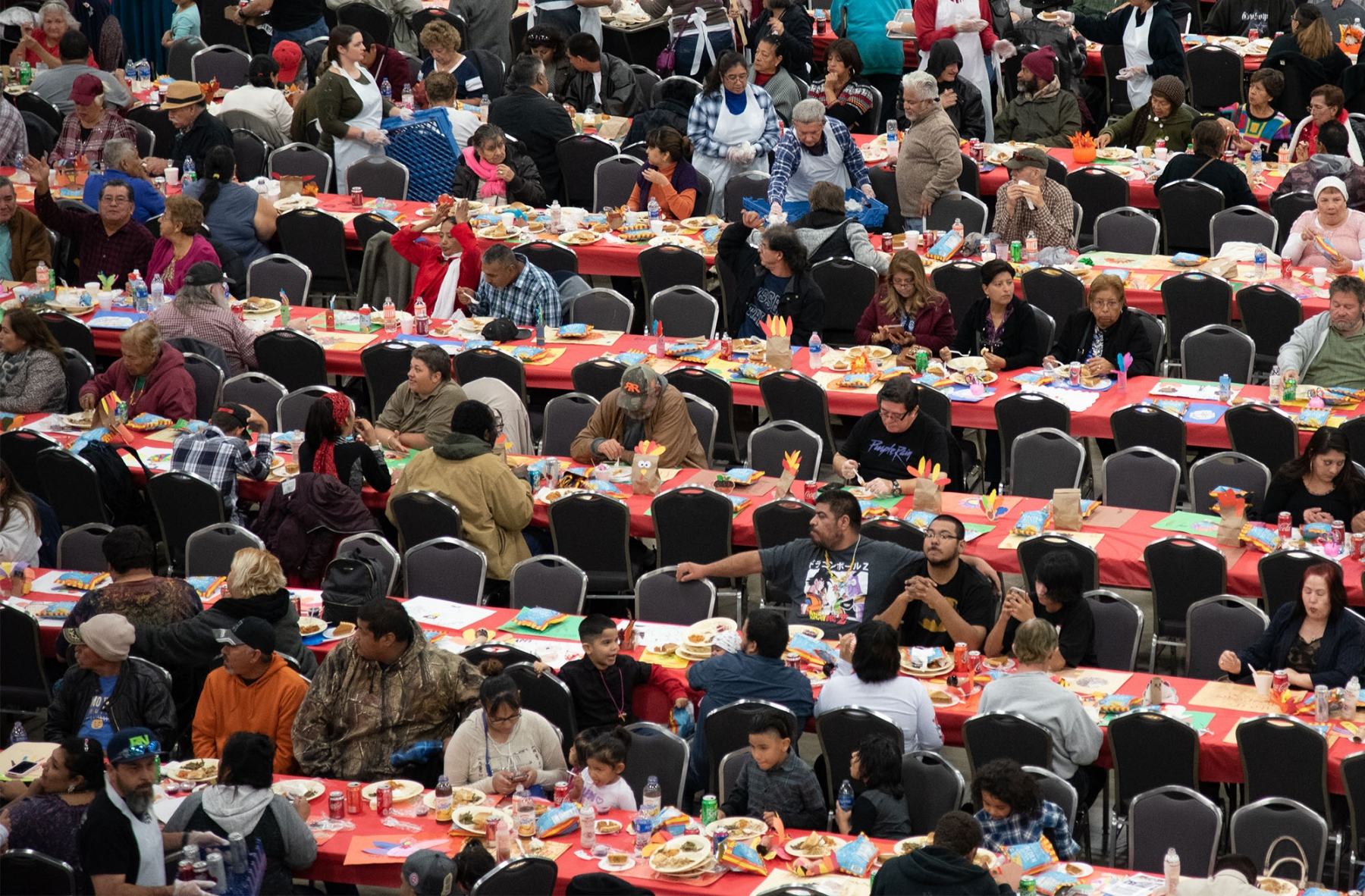 Every year, the Raul Jimenez Thanksgiving Dinner feeds about 25,000 people. <em><b>Photo by V.Finster | Heron</b></em>