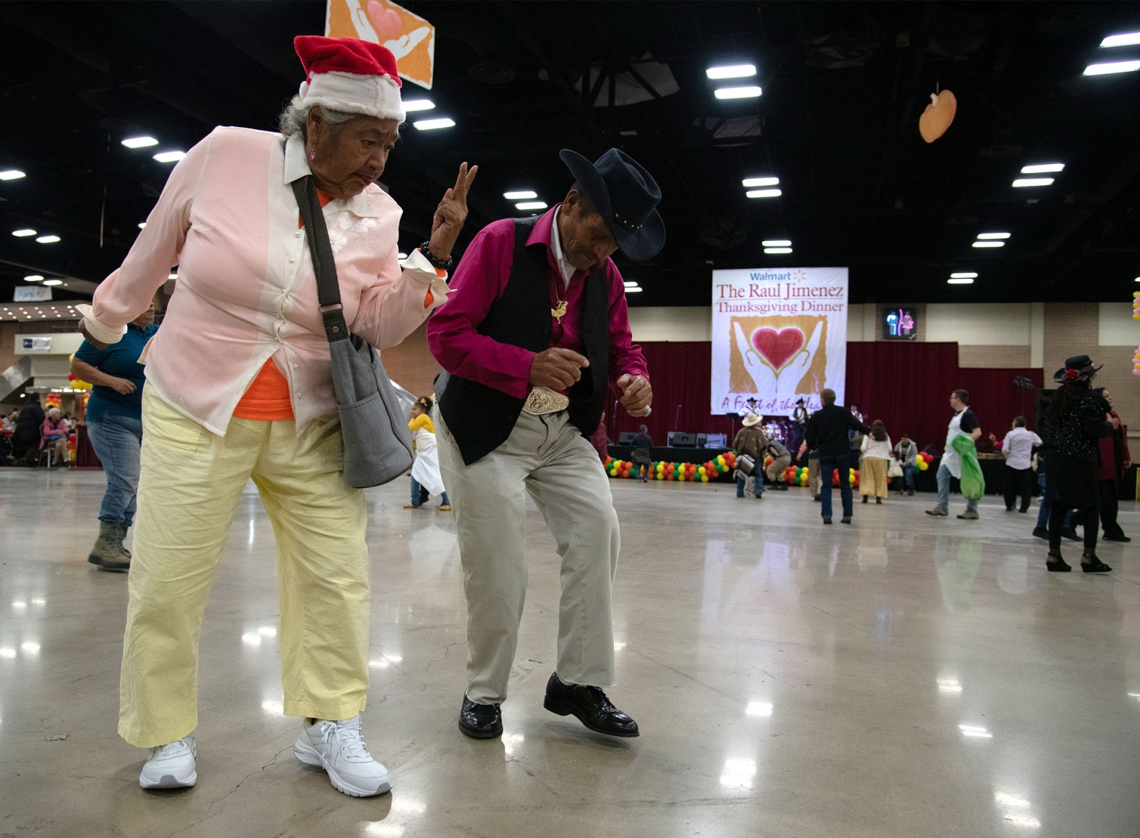 Maria Molina and Jose Salinas dance during the Raul Jimenez Thankgiving Dinner Thursday at the Henry B. Gonzalez Convention Center. <em><b>Photo by V.Finster | Heron</b></em>