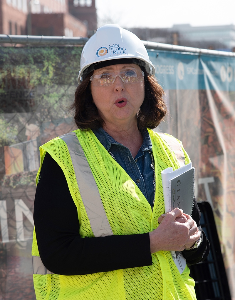 Suzanne Scott, general manager for the San Antonio River Authority speaks at the beginning of a tour over the second segment of Phase 1 of the San Pedro Creek Culture Park Feb. 15.
