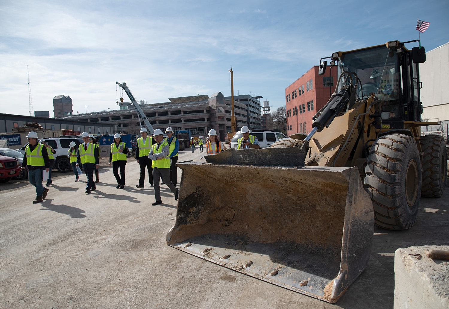 A group tours the construction site of the second segment of the San Pedro Creek Culture Park Feb. 15.