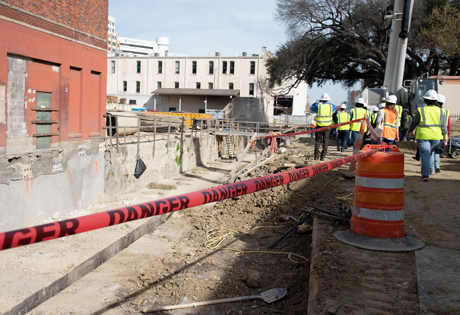 Attendees walk through a construction site during a tour over the second segment of the San Pedro Creek Culture Park Feb. 15.