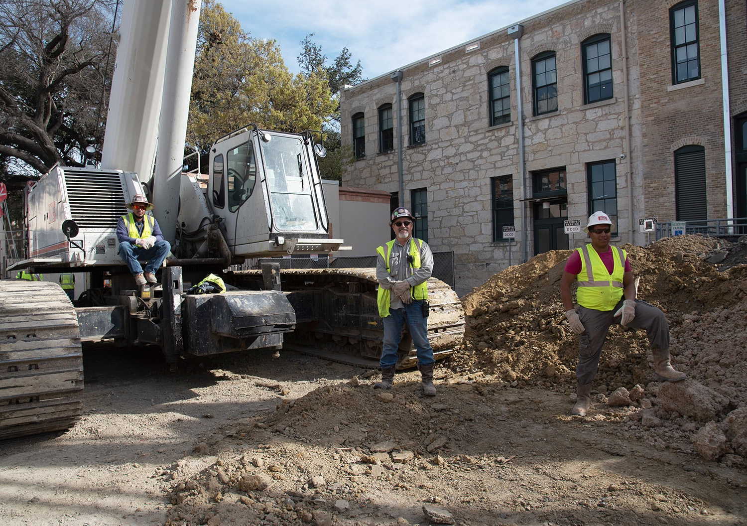 Construction workers on-site during a tour over the second segment of the San Pedro Creek Culture Park Feb. 15.