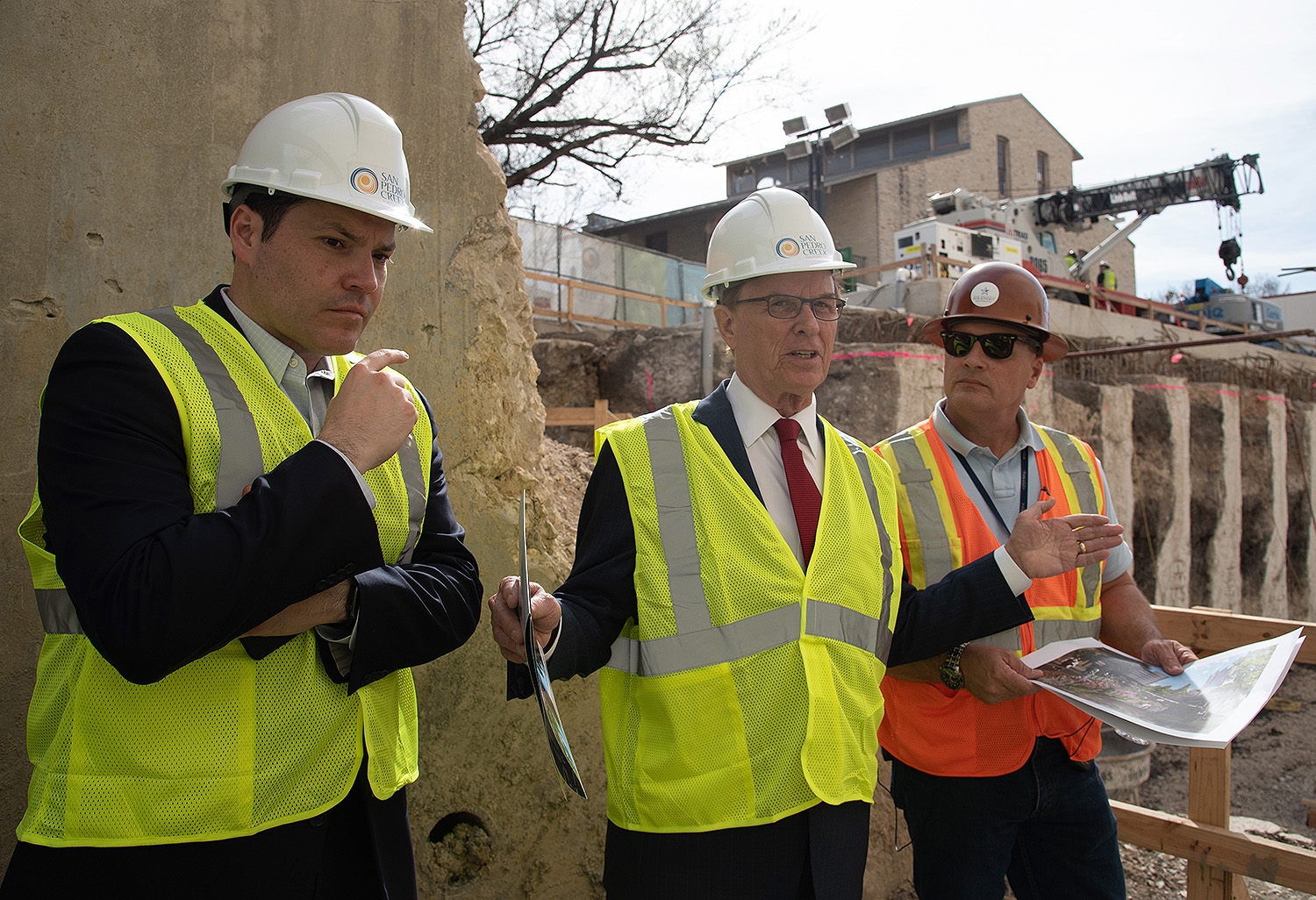 Judge Nelson Wolff (center) speaks at the end of a tour over the second segment of the San Pedro Creek Culture Park Feb. 15. He's flanked by County Commissioner Justin Rodriguez (left) and project manager Kerry Averyt.