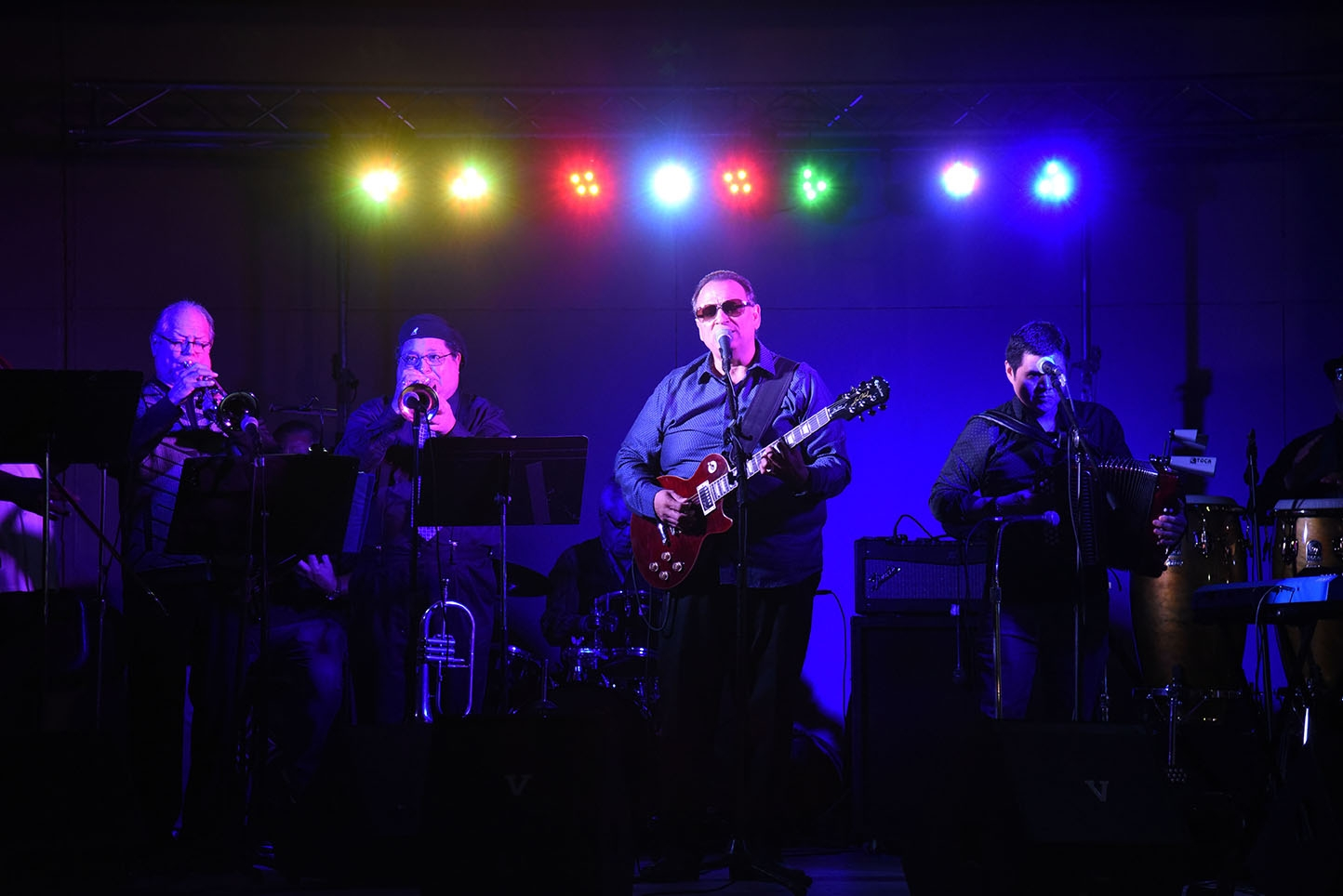 Roger Velasquez and the Latin Legends perform during  the 10th annual Una Noche en La Gloria Oct. 20 on Guadalupe St. <em><b>Photo by V. Finster | Heron</b></em>