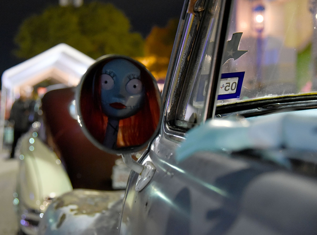A Sallie doll from The Nightmare Before Christmas sits at the steering wheel during the 10th annual Una Noche en La Gloria Oct. 20 on Guadalupe St. <em><b>Photo by V. Finster | Heron</b></em>