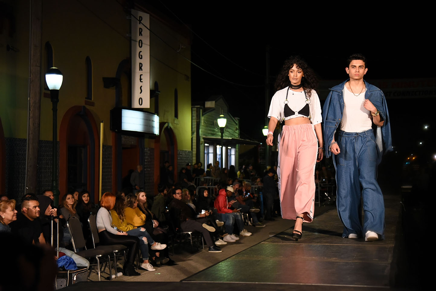 Models walk the runway during Runway En La Calle at the 10th annual Una Noche en La Gloria Oct. 20 on Guadalupe St. <em><b>Photo by V. Finster | Heron</b></em>