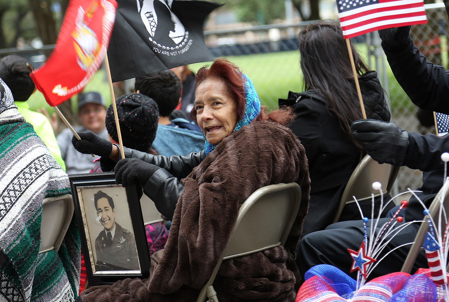 Candy Zuniga holds a photo of her brother, Nicholas Delgado, who is a Korean War MIA soldier. <em><b>Photo by Ben Olivo | Heron</b></em>