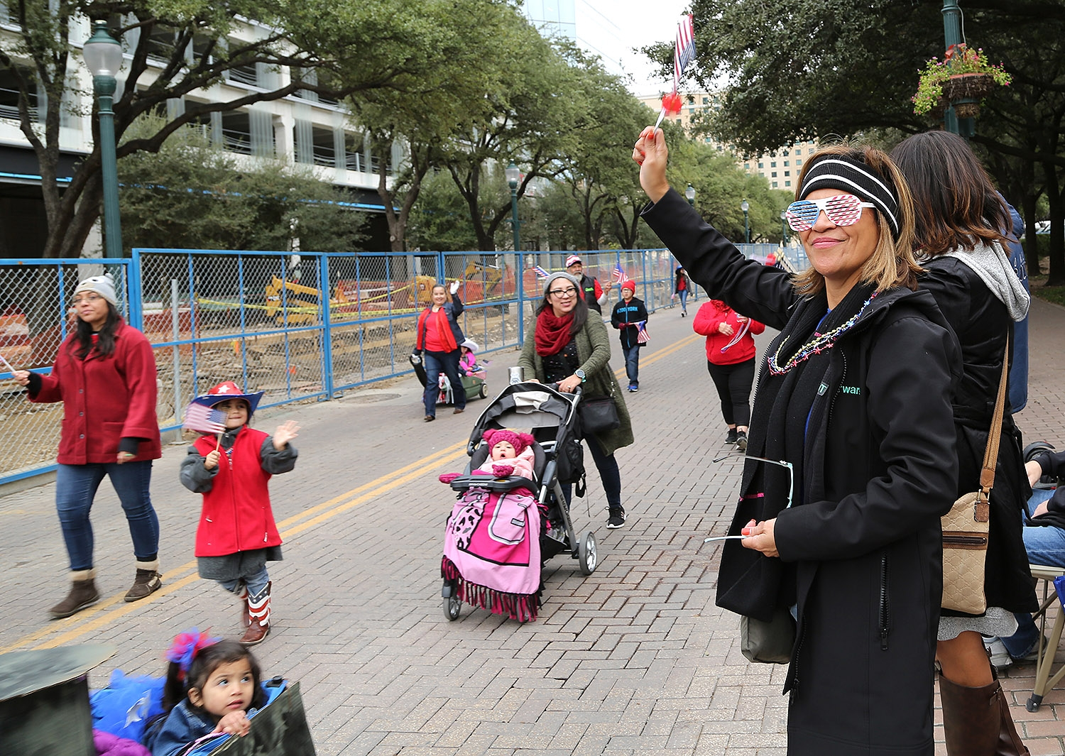 Diane Chavez cheers on participants of the Veterans Day Parade. <em><b>Photo by Ben Olivo | Heron</b></em>