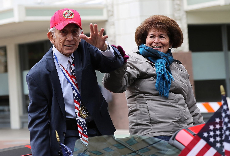 Dr. William Elizondo and his wife, Maria Oralia, participate in the Veterans Day Parade. <em><b>Photo by Ben Olivo | Heron</b></em>