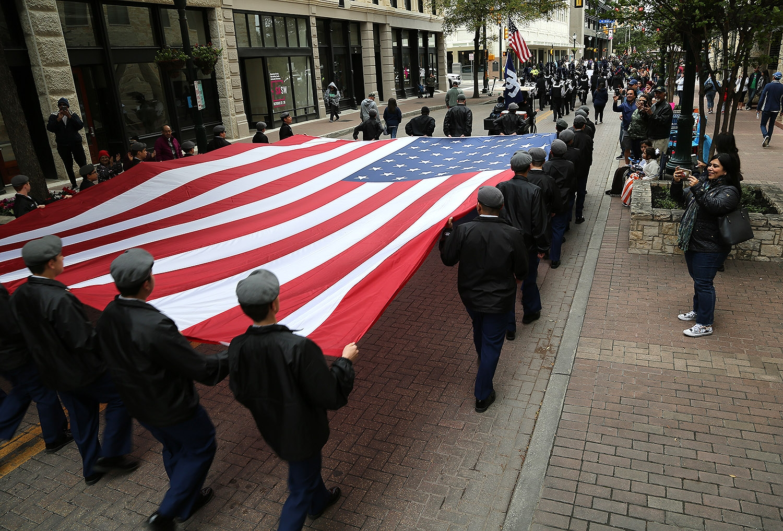 Members of the Central Catholic High School JROTC carry the Stars & Stripes down Houston Street. <em><b>Photo by Ben Olivo | Heron</b></em>