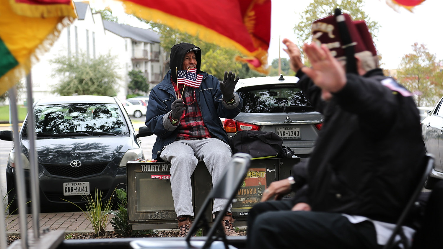 """""""I just wanted to come down and support,"""" said Roger Fuentes, who attended the annual Veterans Day Parade Saturday on Houston Street. <em><b>Photo by Ben Olivo 