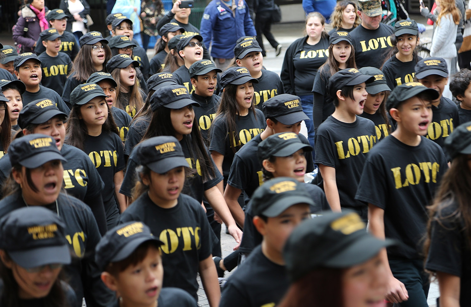 Whittier Middle School students in LOTC March in the Veterans Day Parade Saturday on Houston Street. <em><b>Photo by Ben Olivo | Heron</b></em>